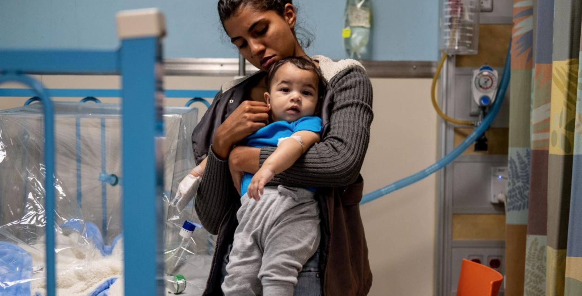 Nurse holding baby boy